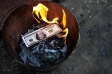 money dollar burning fire Asia Vietnam China