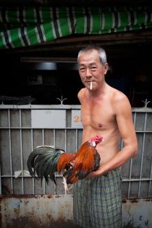 Vietnamese man holding his big cock by Adam Robert Young